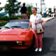 My mother is standing next to Yakov's Ferrari parked just outside the theater.