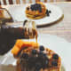 Homemade crispy waffles topped with fresh blueberries and served with maple syrup