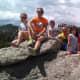 Family at the top of the rocks that border Sylvan Lake.