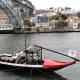 Flat bottomed boat near Ponte de Dom Luis 1, Porto.