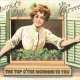 """St. Patrick's Day card: Pretty woman dressed in white looking out a window """"Top of the morning to you."""""""