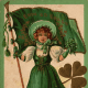 Vintage greeting card: Pretty woman dressed all in green and  holding Irish flag for St.Patrick's Day