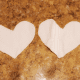 Cut out two heart shapes.