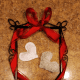 Secure fabric hearts to the frame with floss or twine.