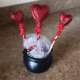 Arrange your hearts in your cauldron or container.