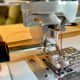 Remove the regular pressure foot holder and screw on the walking foot with its clip.
