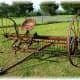 An old harrow farm implement used as decor.