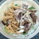 Cooled pasta and flaked mackerel fillet are added to salad