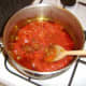 Chopped tomatoes are added to the curry paste