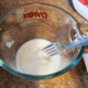 Beat 1 egg into 1/2 cup of milk.