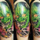 Green hannya tattoo.