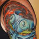 A blue hannya mask tattoo.