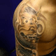 Hannya mask on the shoulder.