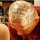 Text tattooed on scalp.