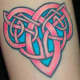 A vibrant pink and blue knot. (by Josh Howard, Deluxe Tattoo, 1459 W. Irving Prk. Chicago, Illinois)