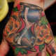 Hourglass tattoo on hand