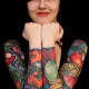Full-sleeve cornucopia tattoos.
