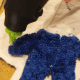 Glue around the edge of the stuffed animal to secure the fabric to the front of your stuffed animal.