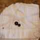 Sew two buttons onto the fabric for the head.