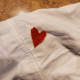 Cut a heart shape from your red fabric and place it.