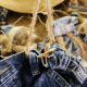 To attach the jeans to the wreath, run a piece of twine through the front and back belt loops and tie to the wreath.