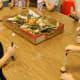 PreK class observing mushrooms