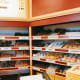 As soon as you enter the donut shop, you've got to see the scrumptious and sugary donuts displayed on the shelves. Yum!