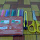 colorful markers, penknife,scissors