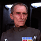 Peter Cushing as Grand Moff Tarkin in Star Wars.  His image was used to reprise the Moff Tarken character in Rogue One