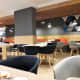Dining tables in Holiday Inn Express London Heathrow Terminal 4.