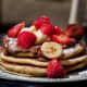 pancakes with peanut butter and fruits
