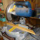 Using the bench mitre saw to cut the facings to size.