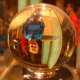 The author's son stands behind a crystal ball, and appears upside down through the crystal.