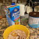Put measured oats, Malt-O-Meal, peanut butter, sweetener, almond milk and Ovaltine in a tall-sided bowl