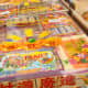 """Chinese Ghost Festival prayer """"packs."""" These all-in-one packs are widely sold in modern times to save families the hassle of selecting and buying different paper offerings."""