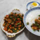 Serving suggestion for mixed stir-fry with tai tow choi: congee with a salted duck egg