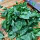 On a cutting board, roughly chop the fresh basil.