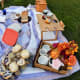 The picnic table can also be converted into a charcuterie board. The legs can be folded underneath the table.