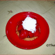 Strawberry Tartlet with whipped double cream. Ready to be eaten.
