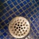 Shower Drain.  Unscrew the screws holding it in place first.  Be careful not to let screws go down the drain.