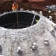 A bio-digester dome under construction.