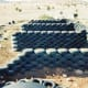 Rammed earth tire walls in typical U pattern for Earthships.