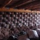 Earthship interior rammed earth tire walls before mudding.