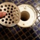 Uncovered Shower Drain.  Take off the drain.