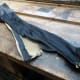 Spare 5 foot zip salvaged from the recycled faux leather; for potential recycling.