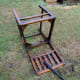 Chair on lawn being deep cleaned with a pressure washer.