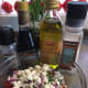 Pour blended olive oil and vinegar over tomatoes, mix gently, refrigerate for about an hour and enjoy!