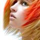 Orange highlights on blonde hair.