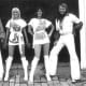 The well-known band, ABBA, wearing white disco clothing.