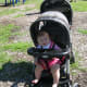The Baby Trend Double Stroller moves well over grass or mulch, as in this park.